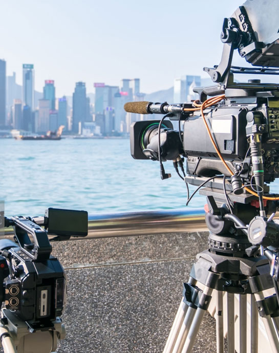 Video equipment in front of city skyline
